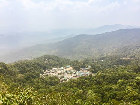 Panorama view of Doi Pui's Hmong ethnic hill-tribe village, aerial view green forest on the mountain background. Doi Pui Hmong tribal village is located on Doi Suthep-Pui national park, Chiang Mai.
