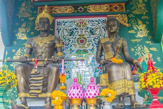 King Mangrai and his queen statues at Wat Ming Muang Buddhist temple, Chiang Rai, Thailand. King Mangrai, also known as Mengrai. He founded the city of Chiang Rai as his new capital of Lanna in 1262.