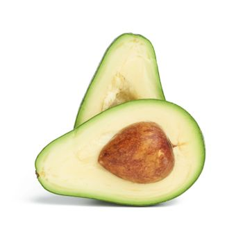 half ripe green avocado with a brown stone isolated on a white background, healthy and tasty fruit