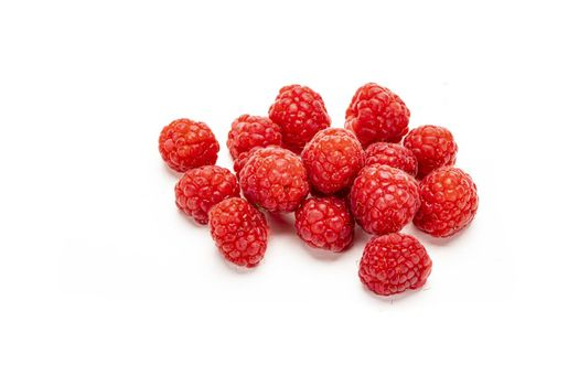 Fresh ripe raspberries isolated on white background.