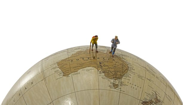 little figures backpaking australia as a big adventure with backpack and walking on a globe