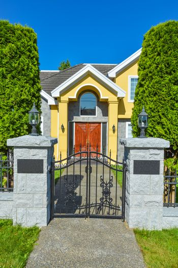 Entrance of luxury family house with cast iron gates in front
