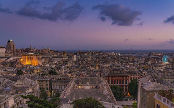 Genoa at sunset from Spianata Castelletto, Italy.