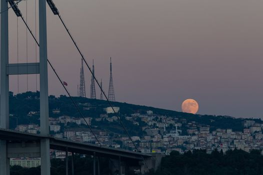 Moonrise over Camlica Hill in Istanbul City, Turkey