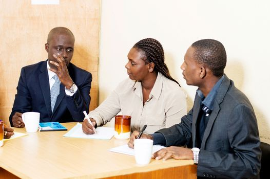 A team of business people in meetings and attentive to what they say at the office