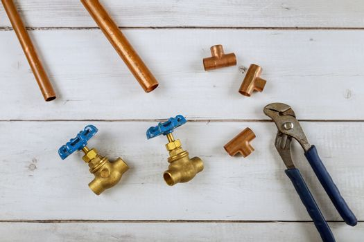 Brass gate valve, monkey wrench brass plumbing fittings on wooden background