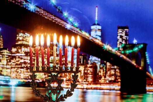 Jewish Holiday symbol star of David Hanukkah menorah Hanukkah of lights wide view Brooklyn Bridge New York