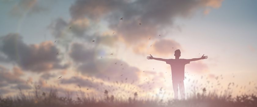 Happy man rise hand Worship God in morning view. Christian spirit prayer praise on good friday background. Male self confidence empowerment on mission arm concept strength wisdom ambitious