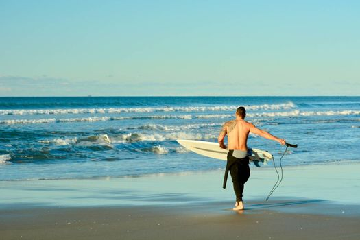 Holidays at the sea; winter time in New Zealand; surfing at winter; wonderful pastime at the seashore