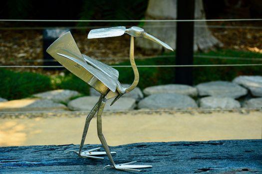 Modern sculpture; concept art; sculpture made of garden tools