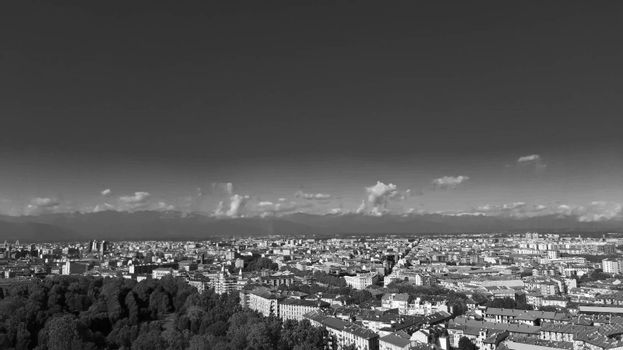 Turin, Italy - 07/02/2020: Travelling around North Italy. Beautiful caption of Turin wih sunny days and blue sky. Panoramic view to the city from Mole Antoneliana. Detailed photography of the old part