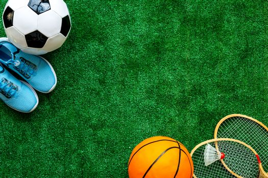 Flat lay of sport balls - football, basketball on grass top view copy space