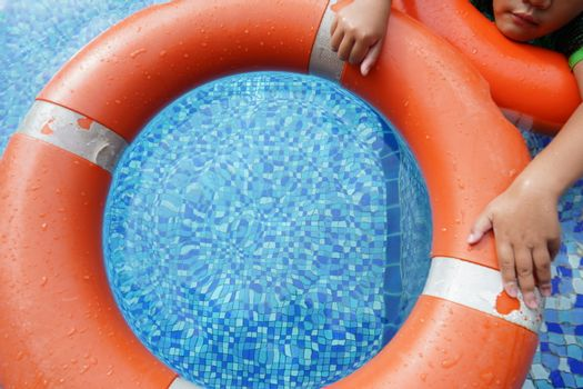Safety equipment, life buoys, or rescue red buoys in the pool to help people from drowning.