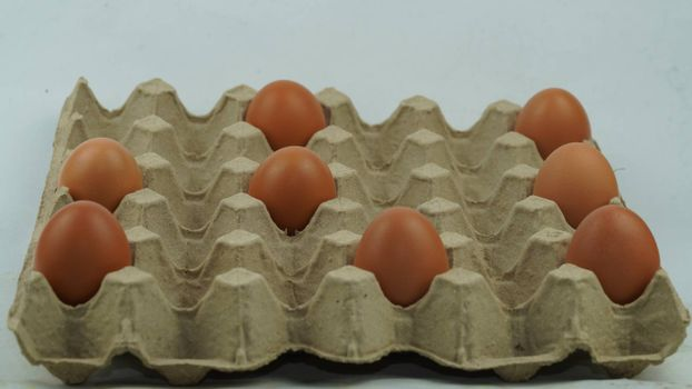 The chicken eggs in the farmer's produce panel are spaced between the eggs.