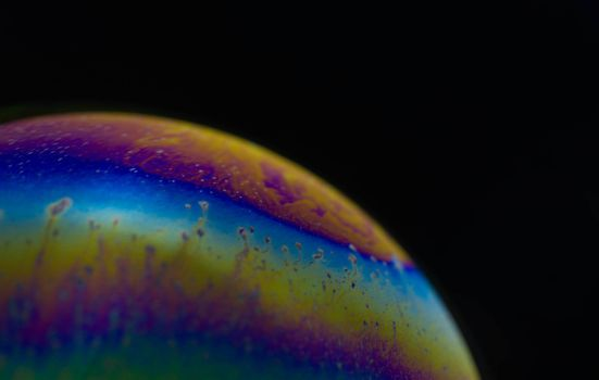 Structure texture soap bubble abstract black background.