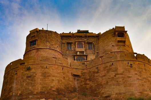 "Golden city fort in Jaisalmer, Rajasthan, India. It is believed to be one of the very few ""living forts"" in the world, as nearly one fourth of the old city's population still resides within the fort."