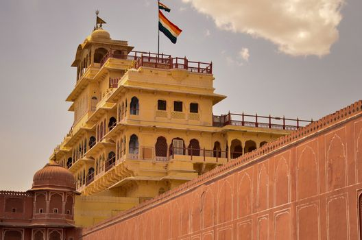 Low angle shot of the top floor which is a restricted area where royal flag is hoisted in Jaipur city palace, Rajasthan, India. An Indian National flag is hoisted there