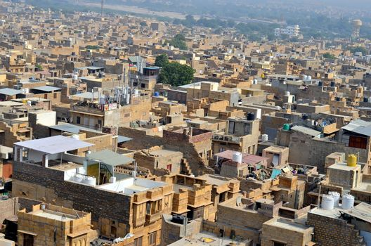 "The golden city as seen from the Jaisalmer Fort. It is believed to be one of the very few ""living forts"" in the world, as nearly one fourth of the old city's population still resides within the fort"