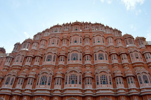 Low angle shot of Hawa Mahal from across the street. Hawa Mahal is constructed of red and pink sandstone. The structure was built in 1799 by Maharaja Sawai Pratap Singh in Jaipur, Rajasthan, India.