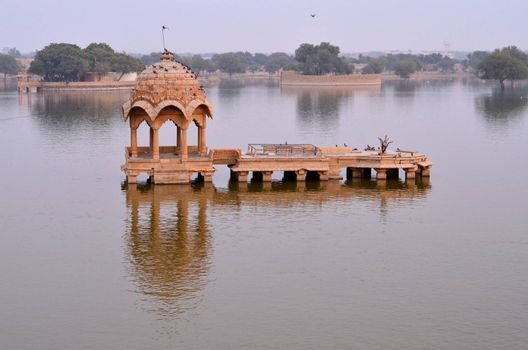 Gadisar Lake in Jaisalmer, Rajasthan, India is an artificial lake built by Raja Rawal Jaisal. Gadi sagar lake is surrounded by artistically carved Sandstone Chattri, Temples, Shrines and ghats.
