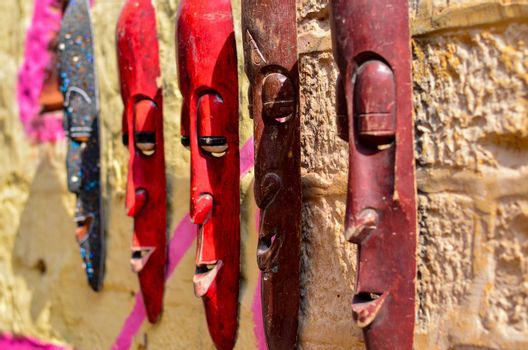 Elongated wooden masks on display and sale in a street shop inside Golden Jaisalmer Fort in Jaisalmer, Rajasthan, India.
