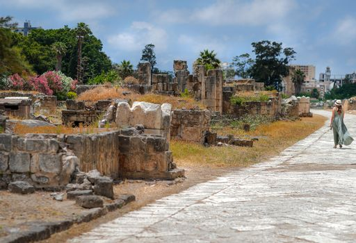 Woman Walking along Ruins Of Tyre