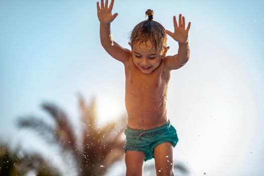 Happy Kid Jumping In the Water