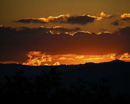 Beautiful summer sunset seen from Mountain View Overlook in Wilkes County, NC looking toward Boone, NC.