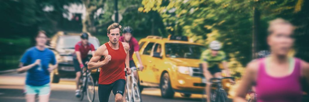 Fit runners motion blur people crowd training in city panorama banner - Athletes jogging, biking in New York city with yellow cabs cars background. Man running fast in blurred motion.