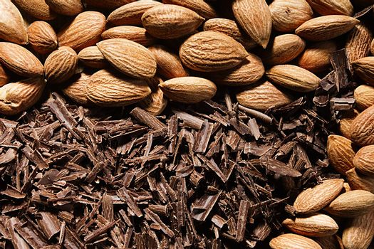 Almond nuts and delicious grated chocolate closeup