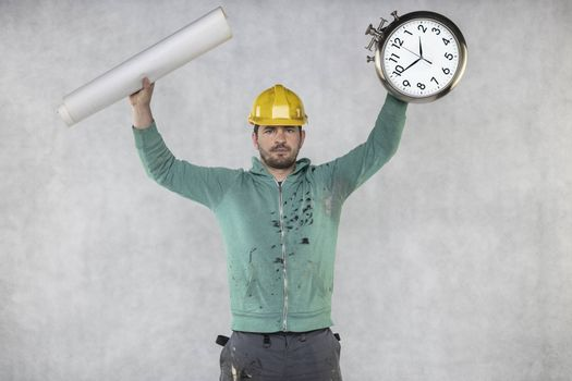 the builder is holding plans and a watch in his hand