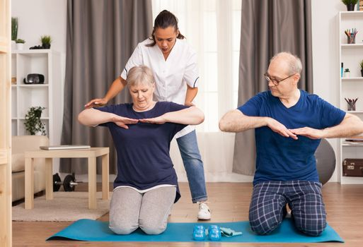 Physiotherapist helping old person to recovery after trauma. Home assistance, physiotherapy, healthy lifestyle for senior old person, training and recovery with professional physiotherapist