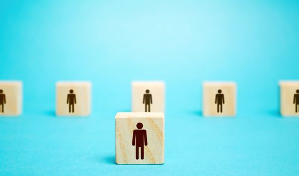 A block man stands out from a row number of people. Leader, leadership skills. Filling of vacancies with professional specialists. Staffing. Talented employee. Concept of individuality and personality