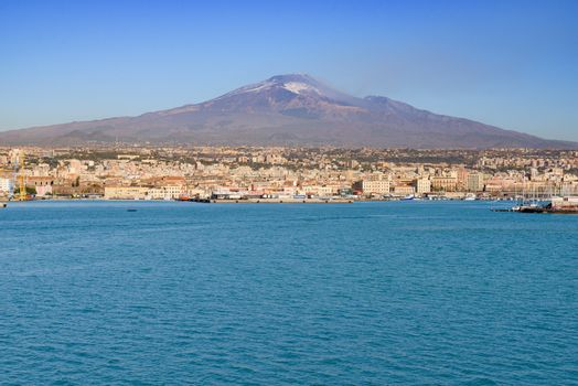 Mount Etna volcano erupting with smoke fumes dominating the Sici