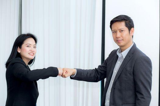 businessmen giving fist bump after business achievement in meeti