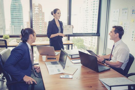 businesswoman presentation to a group in meeting.
