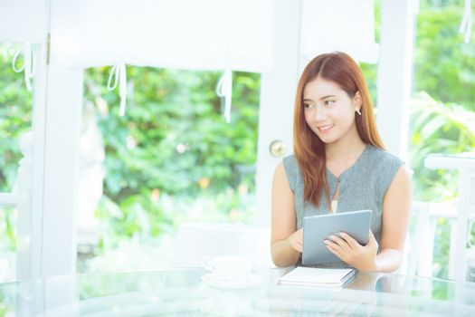 Beautiful businesswoman asian have enjoyed in the garden with ta