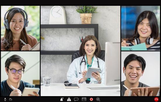 Video conference of asian woman giving consult to group of asia people and teamwork colleague to follow up health care when Coronavirus outbreak, Covid-19 pandemic, online counselling and new normal
