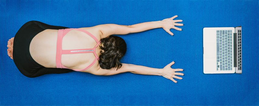 Banner Asian woman practicing yoga from home with laptop when Covid19 outbreak, healthy or Meditation Exercise, workout at home, coronavirus pandemic and quarantine, sports and healthcare in concept