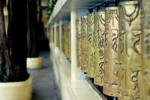 Religious copper buddhist prayer wheels with a prayer mantra wri