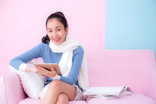 portrait of beautiful young woman relax on couch with tablet communication concept.