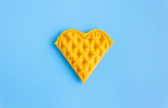 1 Piece Heart Shape Waffle on Blue Pastel Background Minimalist Style. Heart shape waffle dessert in minimalist style for food and dessert category
