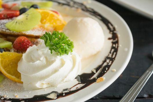 Whipped Cream Ice Cream Chocolate Dessert Strawberry Blueberry Kiwi Lemon Waffle Chocolate Dessert. Fruity dessert food category