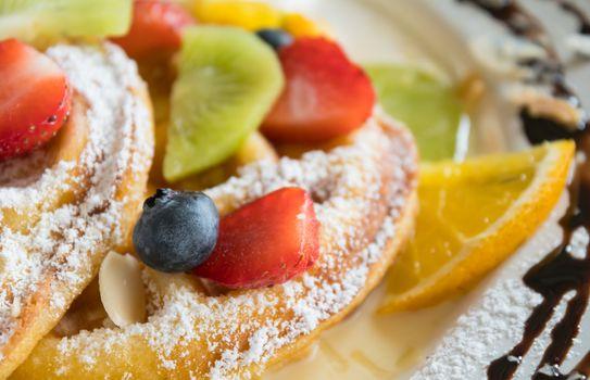 Blueberry Strawberry Kiwi Lemon Waffle Chocolate Dessert. Fruity dessert food and drink category