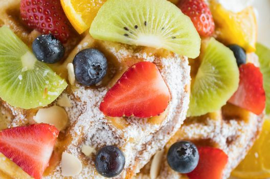Flatlay Strawberry Blueberry Kiwi Lemon Waffle Dessert. Fruity dessert food and drink category