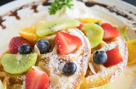 Strawberry Blueberry Kiwi Lemon Waffle Chocolate Dessert. Fruity dessert food and drink category