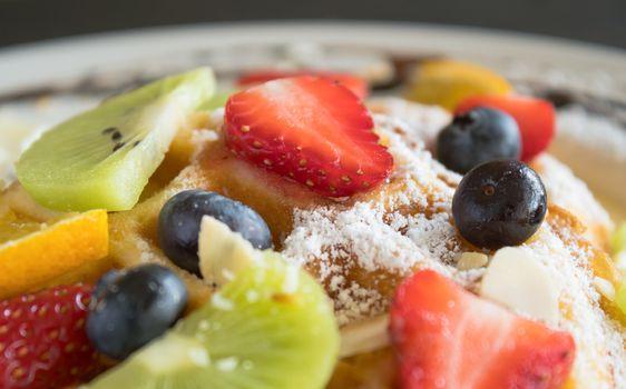 Strawberry Blueberry Kiwi Lemon Waffle Dessert. Fruity dessert food and drink category