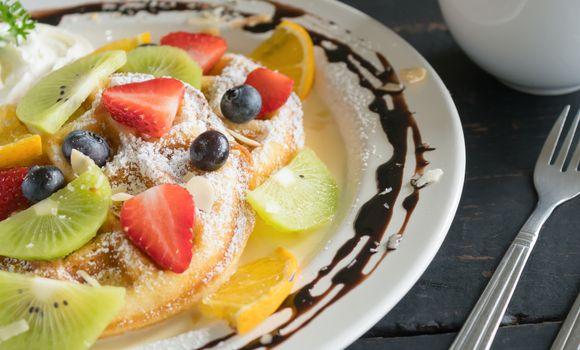 Strawberry Blueberry Kiwi Lemon Waffle Whipped Cream Chocolate Coffee Dessert. Fruity dessert food and drink category