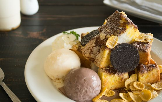 Sweet Toast Bread or Dessert and Cookies and Vanilla Chocolate Ice Cream and Cornflakes and Whipped Cream and Chocolate Cocoa Powder. Dessert toast bread for food and drink category