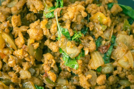 Stir-Fried Pork and Holy Basil and Chili in Close Up View. Delicious Thailand Food Menu for Health in Vintage Tone